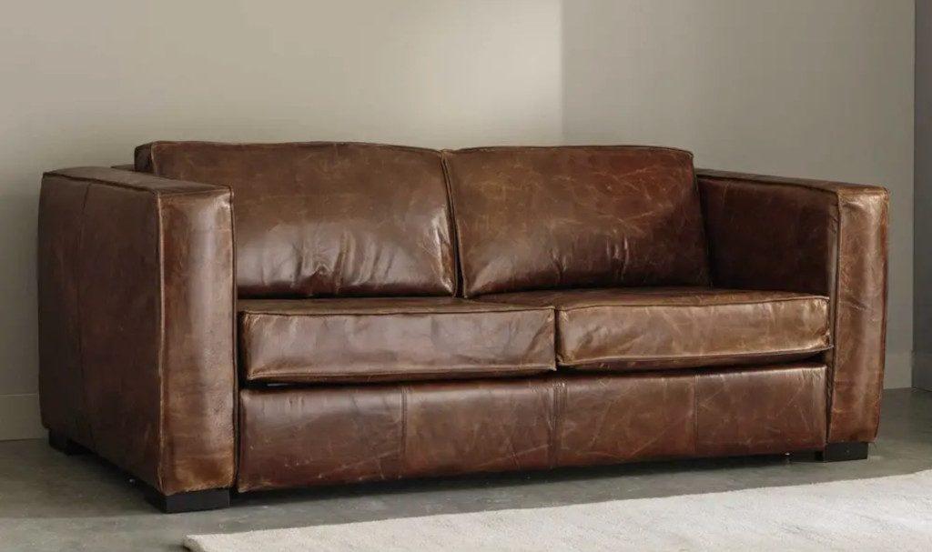 Canapé droit convertible en cuir marron vieilli